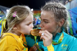 RIO DE JANEIRO, BRAZIL - AUGUST 08: Nicole Beck of Australia kisses her Gold medal with her daughter Sophie Beck after the medal ceremony for the Women's Rugby Sevens on Day 3 of the Rio 2016 Olympic Games at the Deodoro Stadium on August 8, 2016 in Rio de Janeiro, Brazil. (Photo by Alexander Hassenstein/Getty Images)